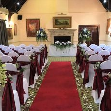 11. Red Aisle Runner, White Chairs Covers & Burgundy Tafetta Sash