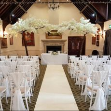 2. Ivory Drapes on White Chivari Chairs
