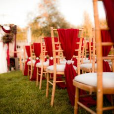 5. Garnet Drapes on Natural Wood Chivari Chairs