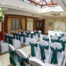 6. White Stretch Chair Covers & Hunter Green Tafetta Sash