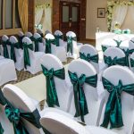 Chair cover with hunter green sash example